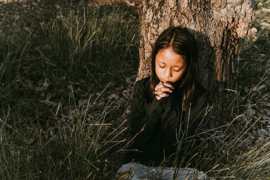 Asian girl praying