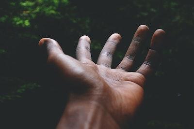 Black hand reaching