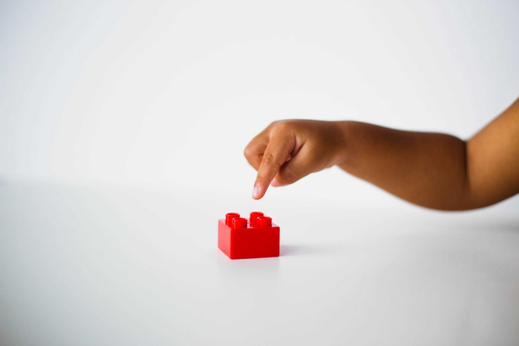 Child With Red Block