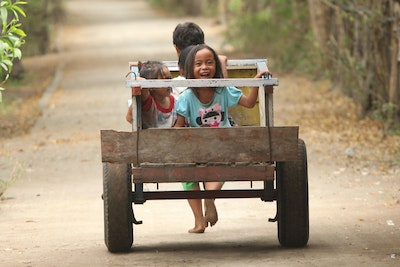 Children playing on cart