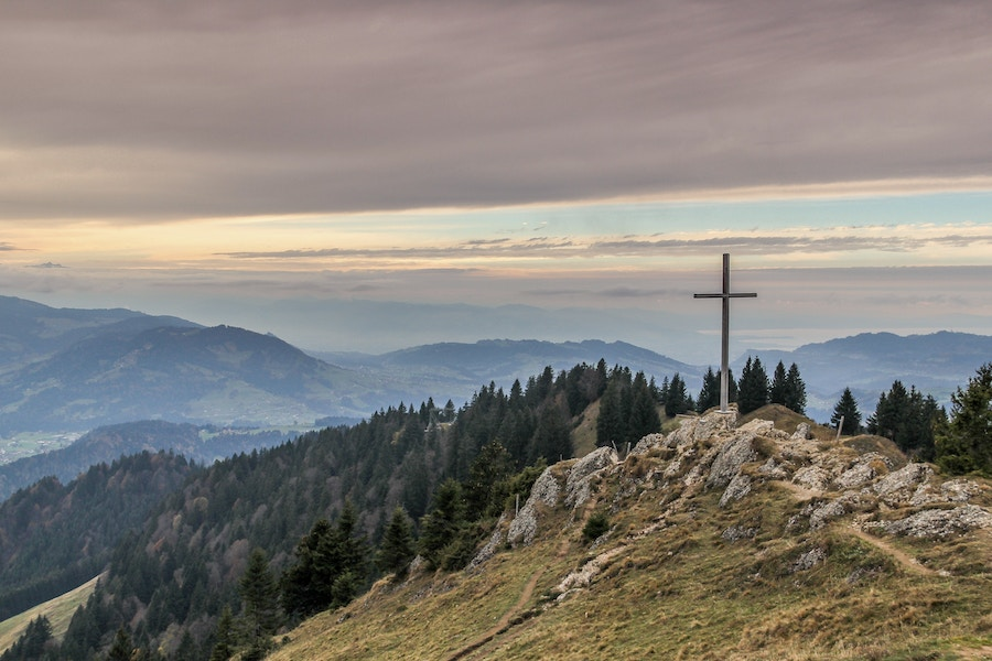 Cross On Hill In Mountains