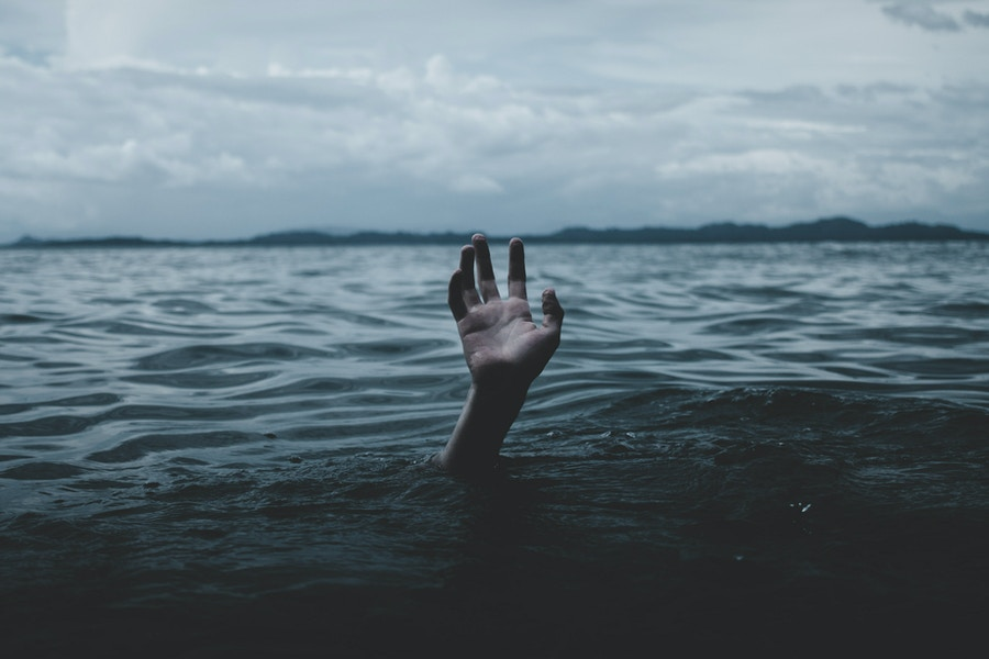 Drowning hand reaching up