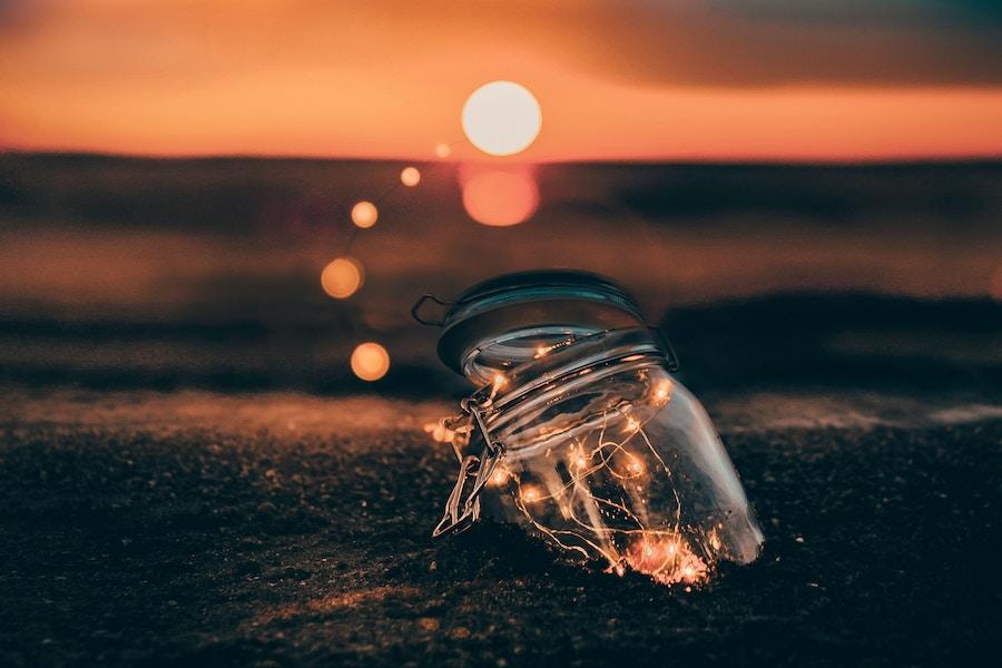 Light jar buried in sand