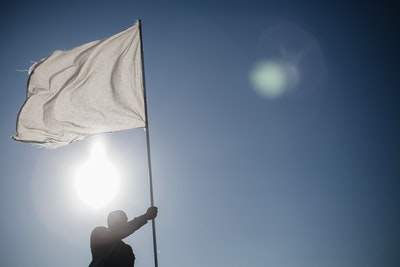 Man Waiving White Flag