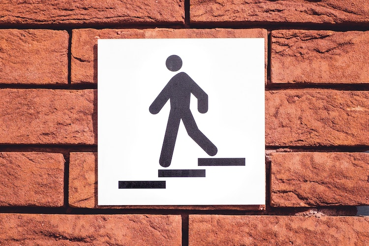 Sign Person On Steps